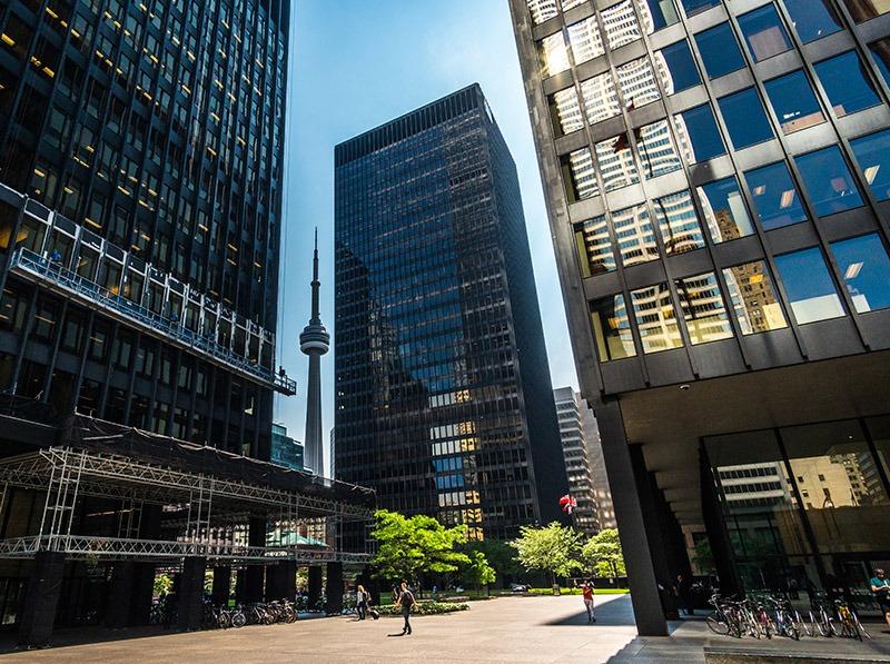 CN Tower peaking between buildings