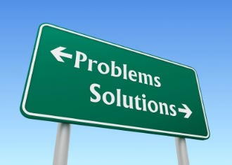 Signage with the words problems and solutions